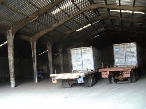 Photos showing the containers into the warehouse